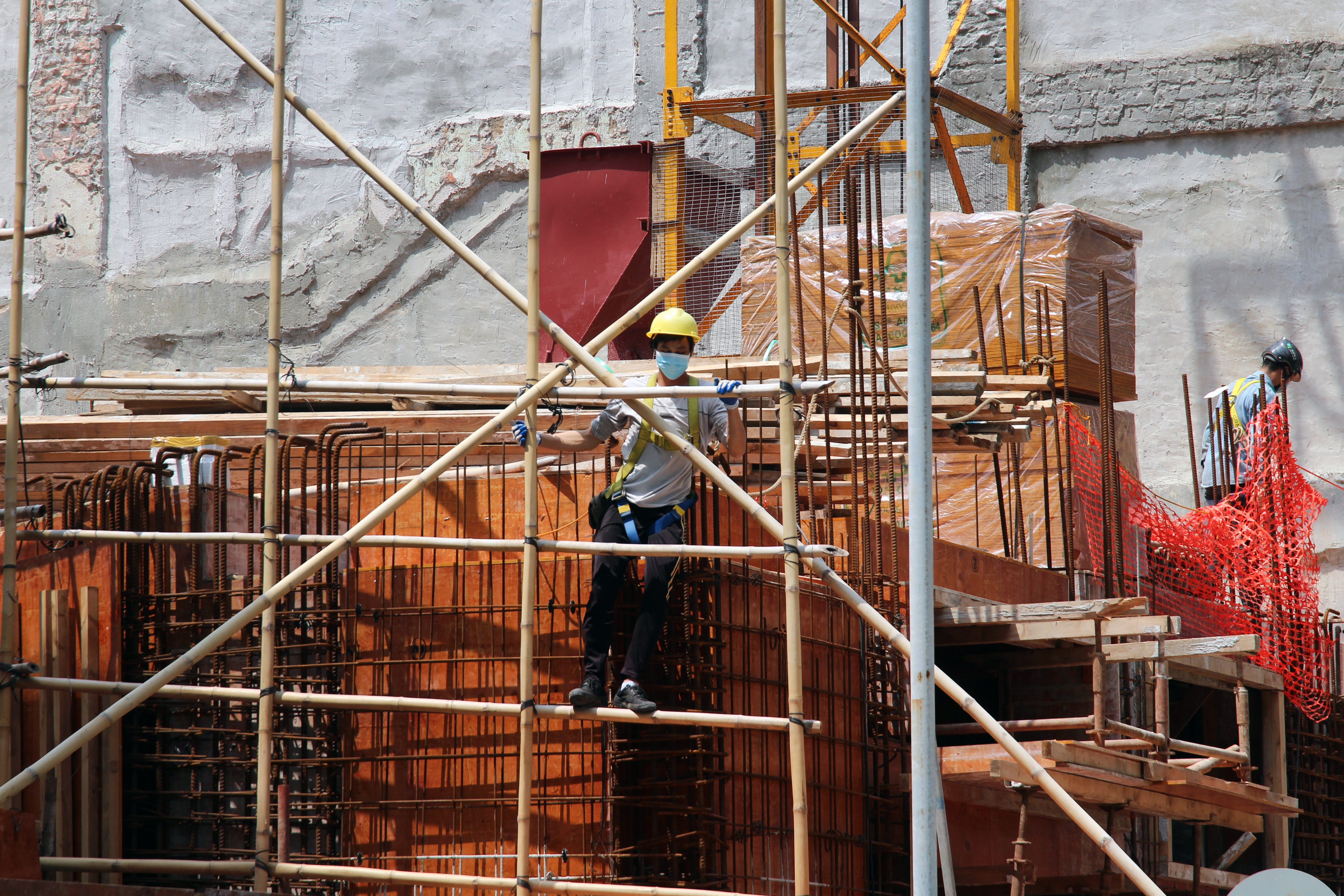 scaffolding with construction workers