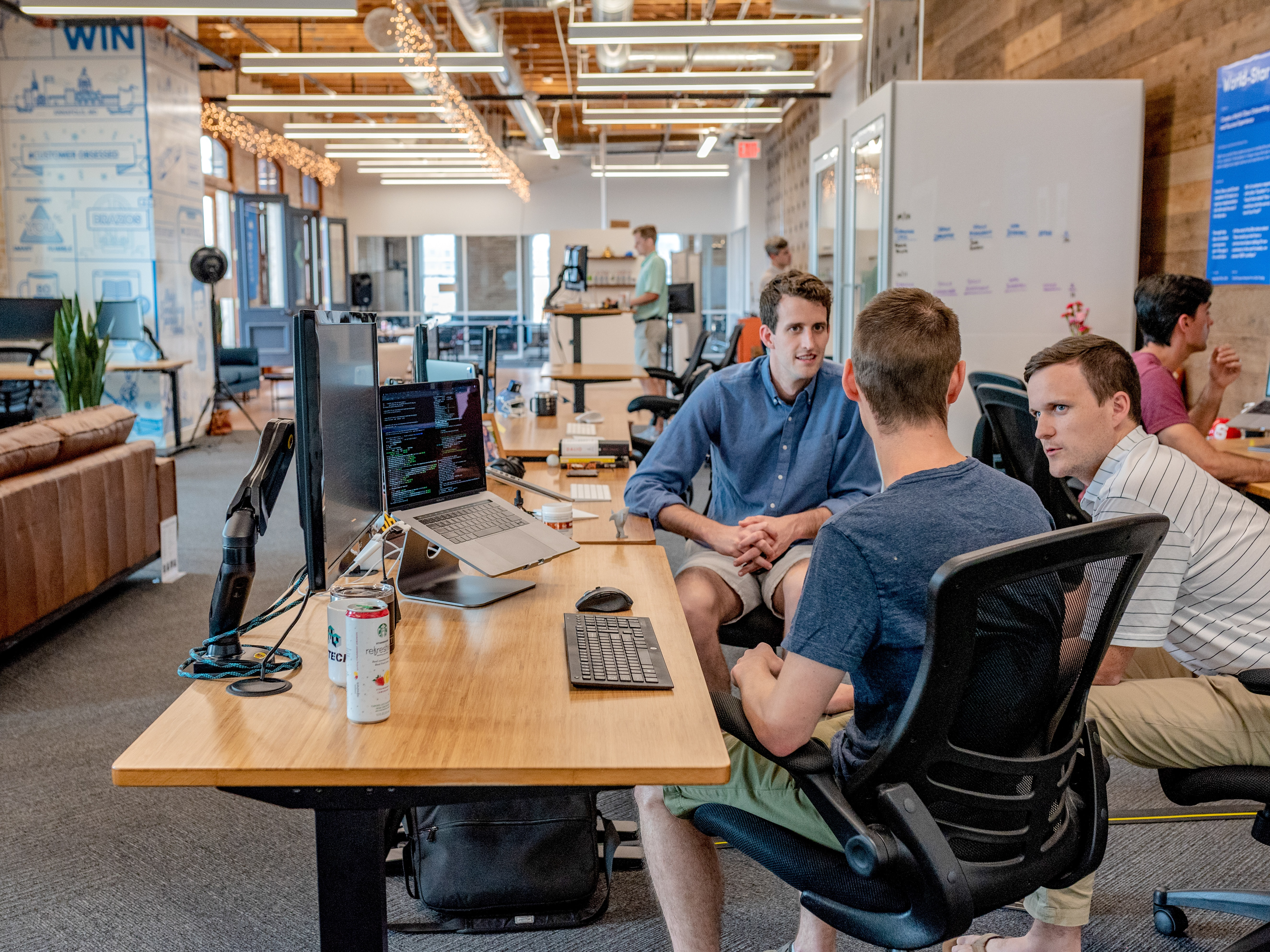 employees collaborating in open office environment
