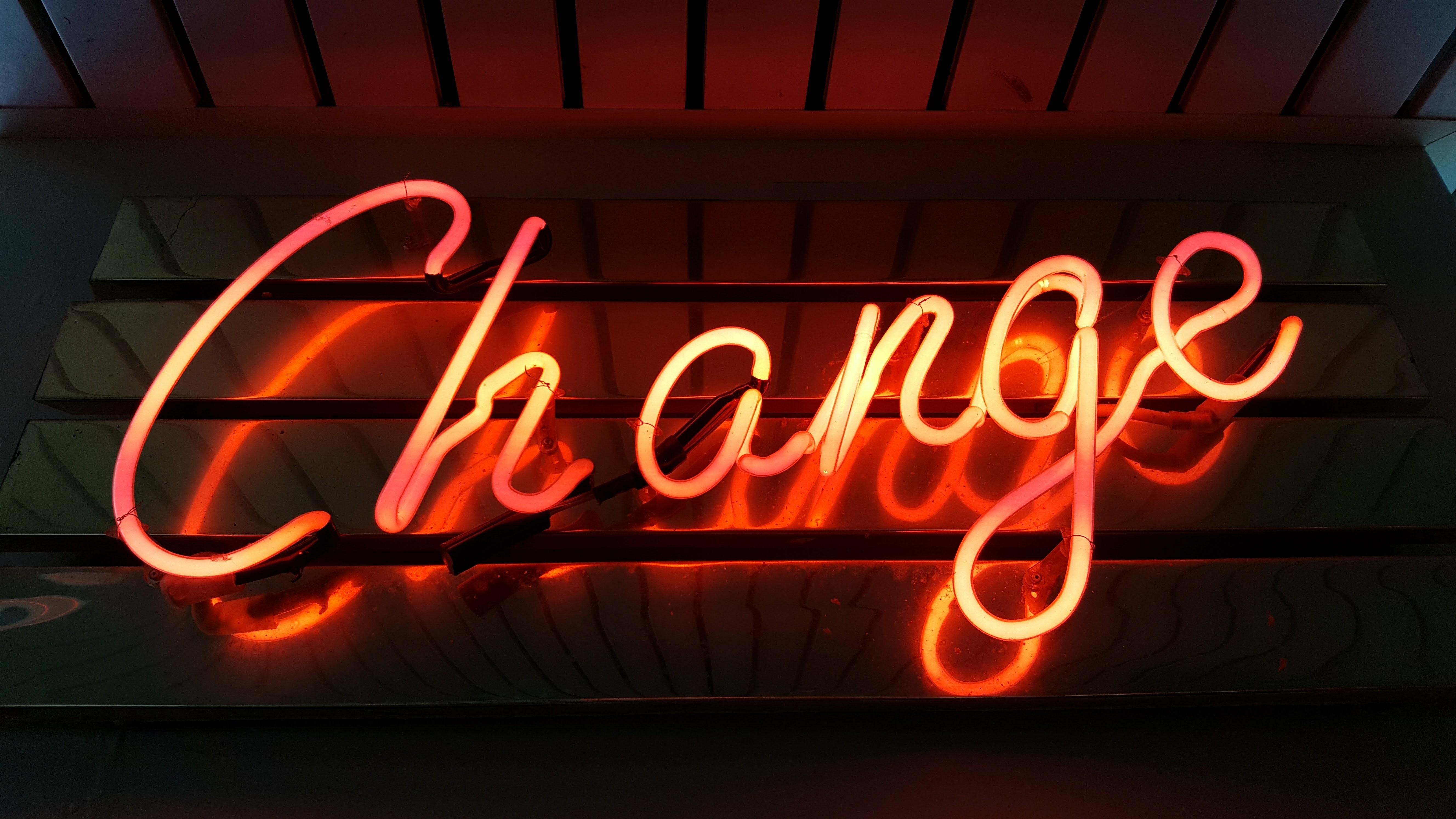 neon sign spelling out the word 'Change'