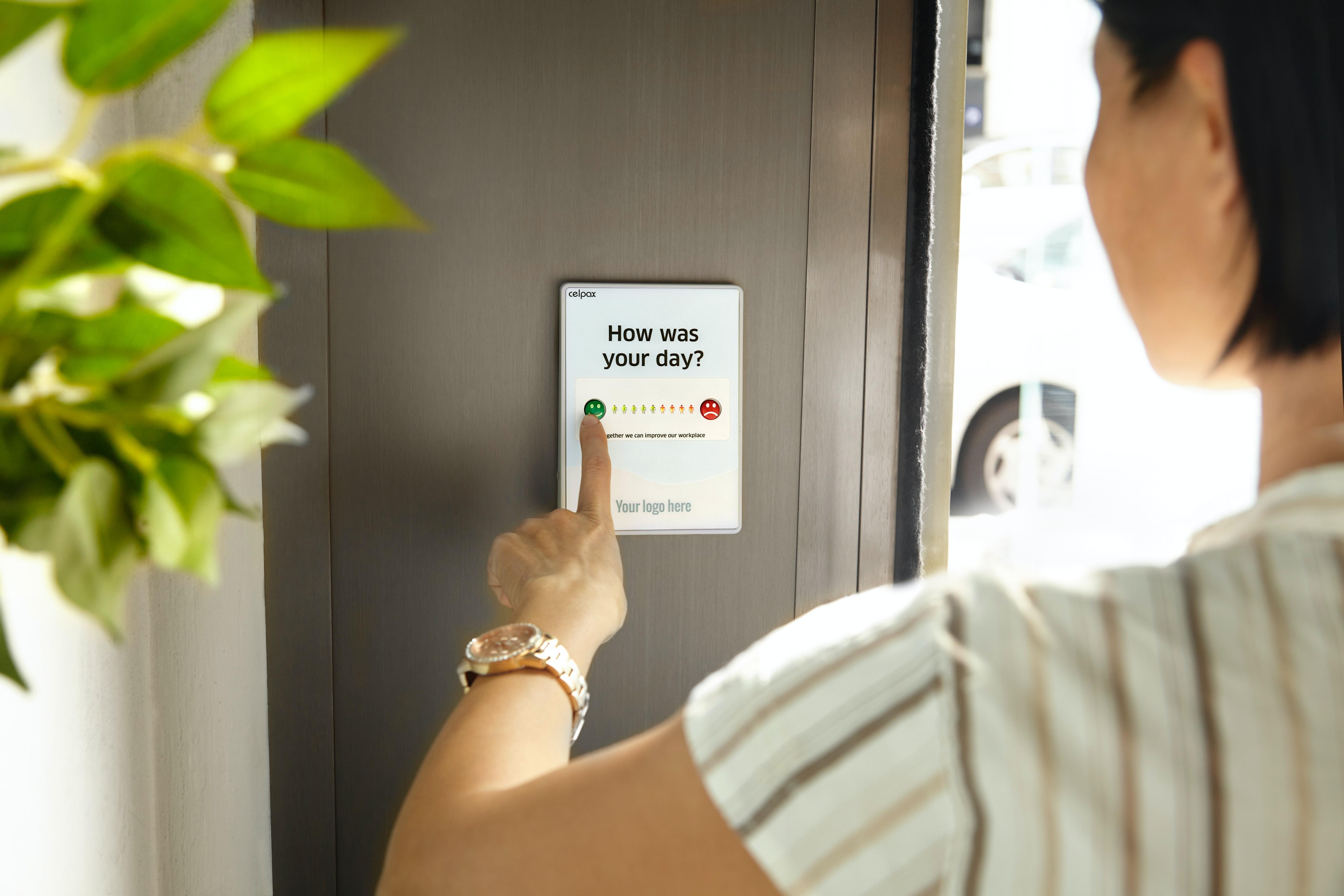 Woman answering a poll on an iPad.