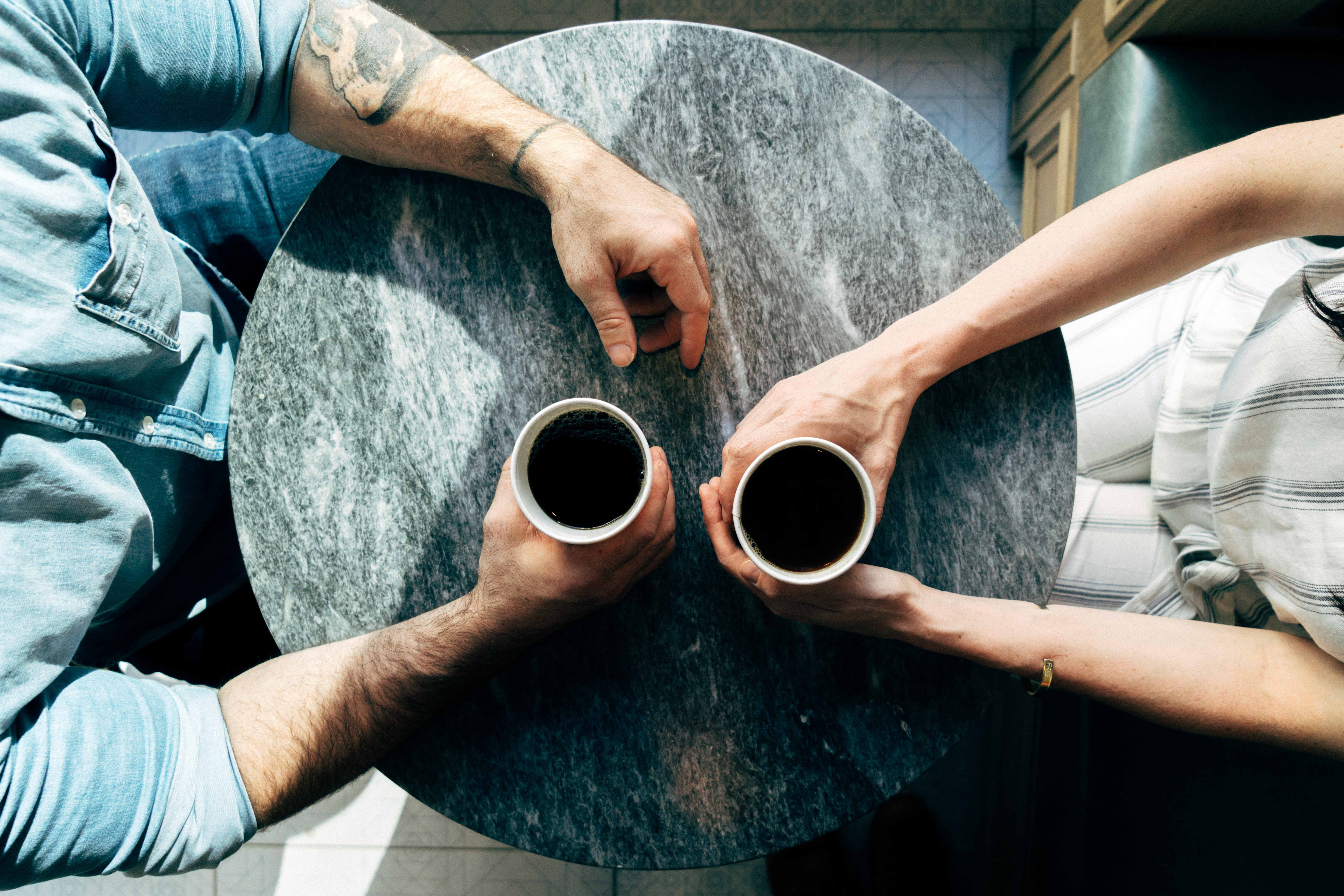 aerial shot of people meeting over coffee