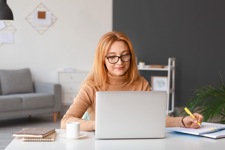 Professional woman attending a class on a laptop computer