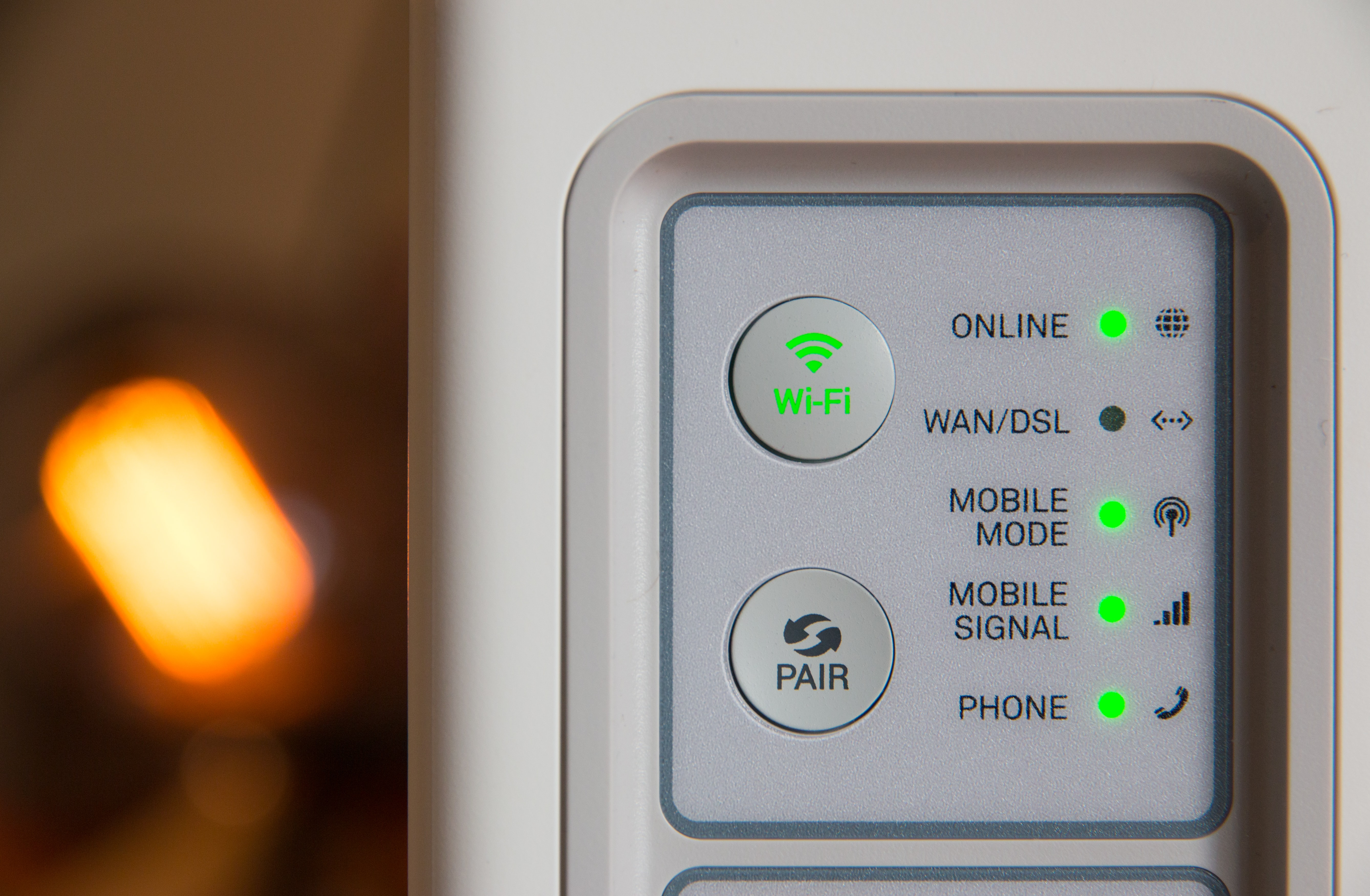 Internet router displaying Wi-Fi and phone connection