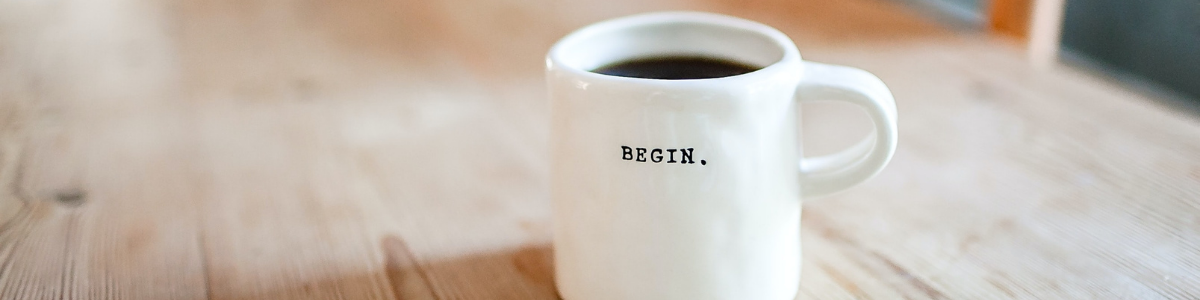 A coffee mug with the word 'begin' on it