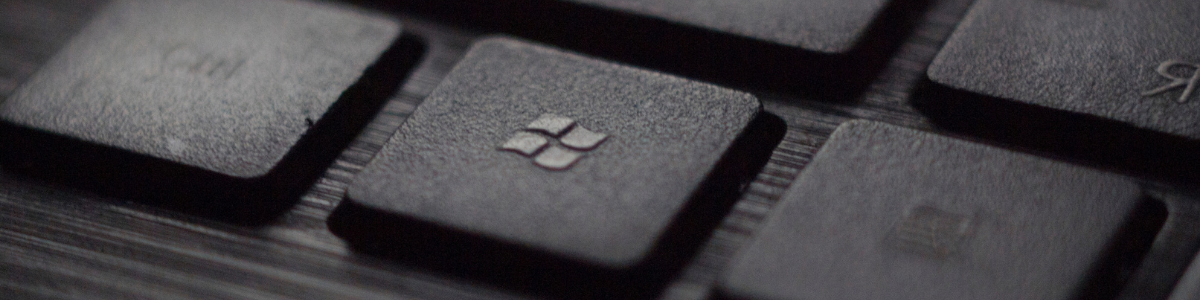 Close-up of computer keyboard, specifically drawing attention to the Windows key