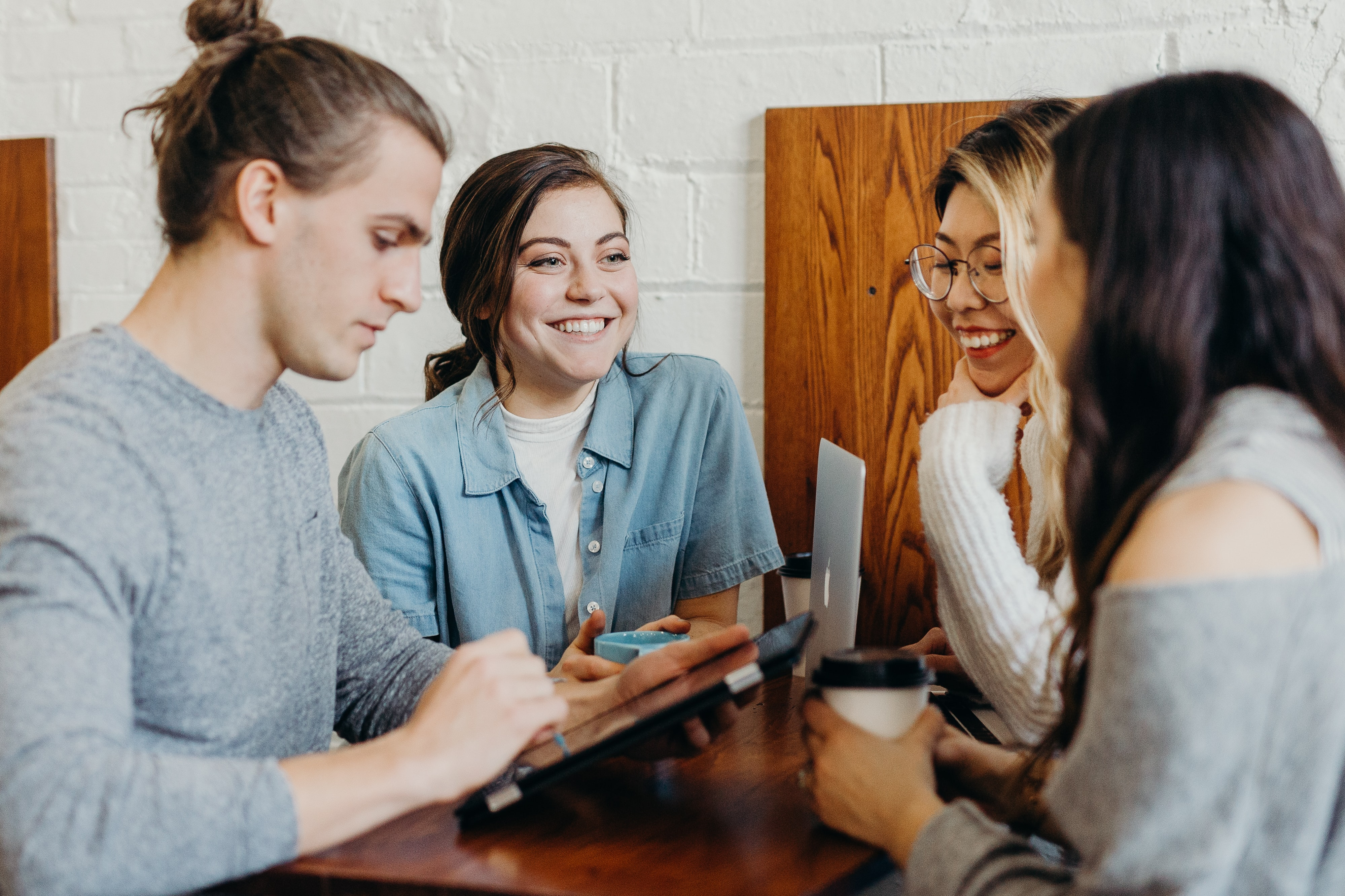 Smiling coworkers sitting together at table