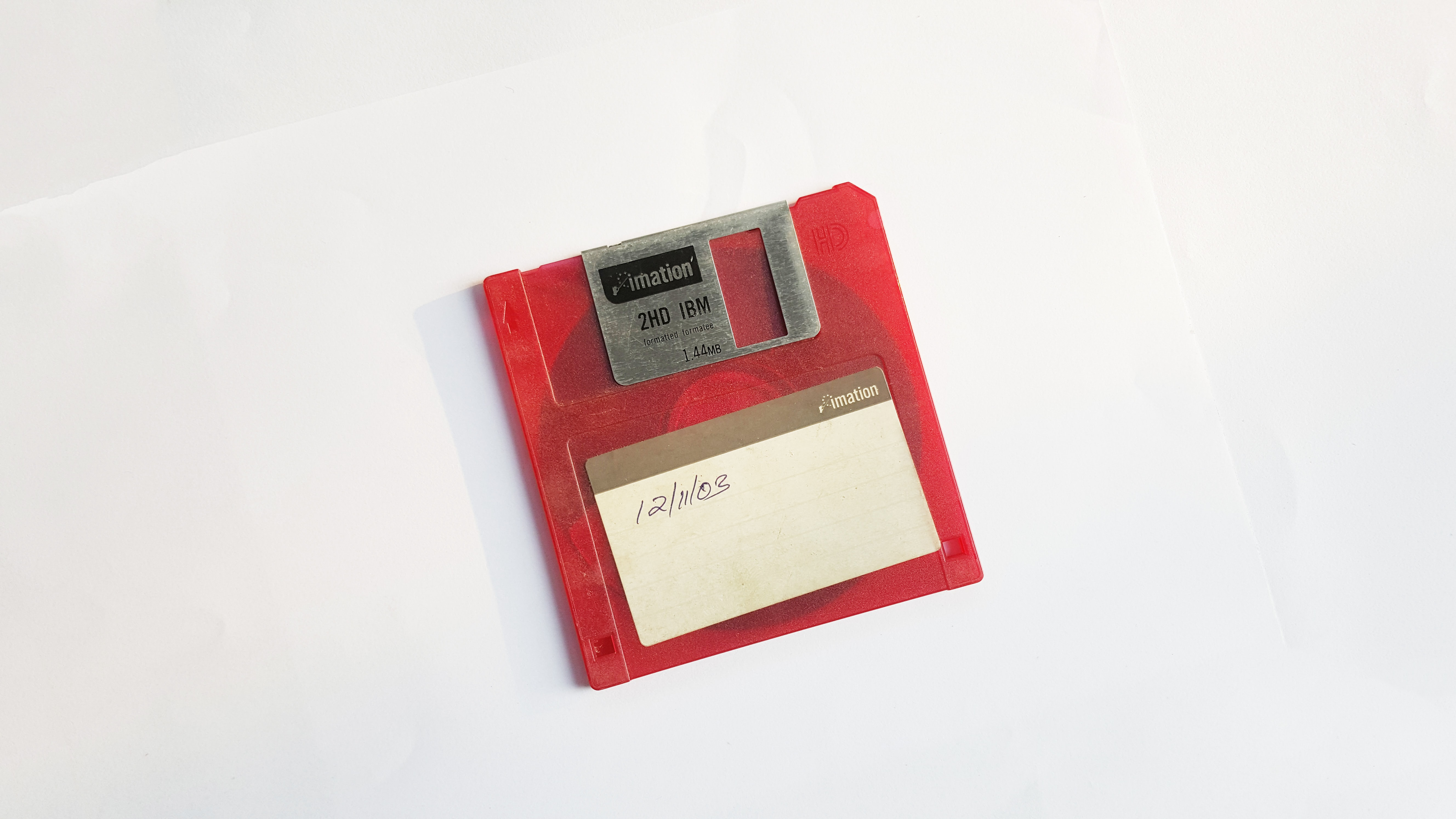 red 'floppy' storage disk on a white table